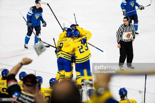 Sweden´s defender John Klingberg and team mates celebrate scoring the 2-1 goal during the IIHF Men's World Championship Ice Hockey semi-final match...