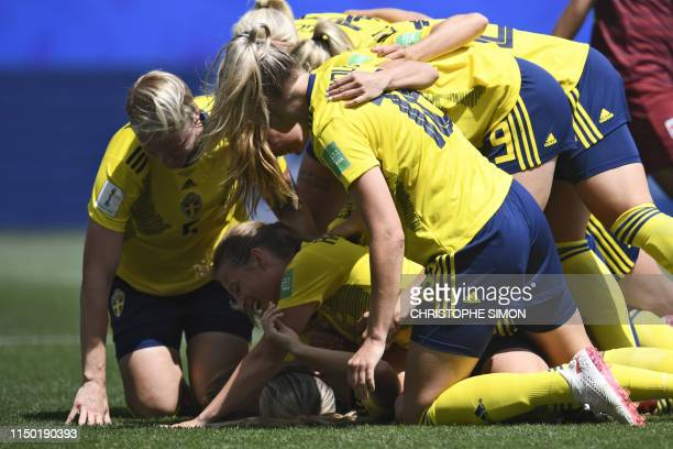 TOPSHOT Sweden's defender Linda Sembrant is congratulated by teammates after scoring a goal during the France 2019 Women's World Cup Group F football...