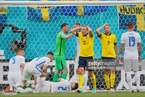 Sweden's defender Ludwig Augustinsson and Sweden's forward Marcus Berg react after missing a goal opportunity during the UEFA EURO 2020 Group E...
