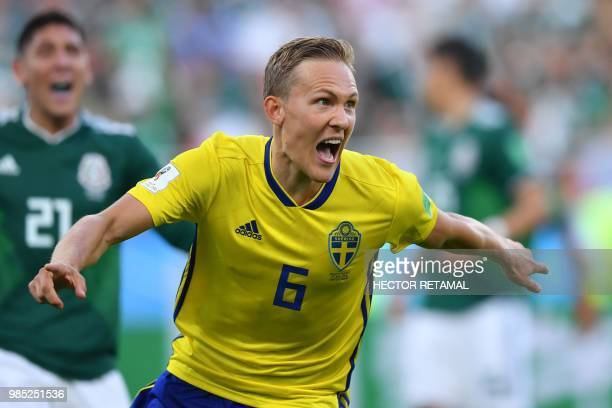 TOPSHOT Sweden's defender Ludwig Augustinsson celebrates after scoring the opening goal during the Russia 2018 World Cup Group F football match...