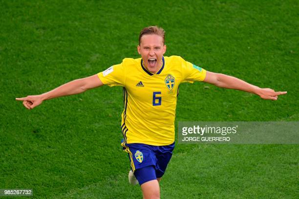 TOPSHOT Sweden's defender Ludwig Augustinsson celebrates scoring the opening goal during the Russia 2018 World Cup Group F football match between...
