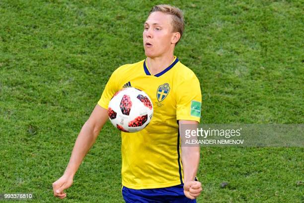 Sweden's defender Ludwig Augustinsson controls the ball during the Russia 2018 World Cup quarterfinal football match between Sweden and England at...