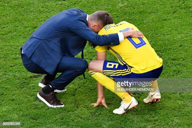 Sweden's defender Ludwig Augustinsson reacts after losing the Russia 2018 World Cup quarterfinal football match between Sweden and England at the...