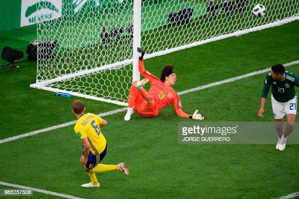 TOPSHOT Sweden's defender Ludwig Augustinsson scores the opening goal past Mexico's goalkeeper Guillermo Ochoa during the Russia 2018 World Cup Group...