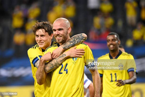 Sweden's defender Marcus Danielson celebrates with his teammate Sweden's defender Victor Lindelof after scoring during the friendly football match...