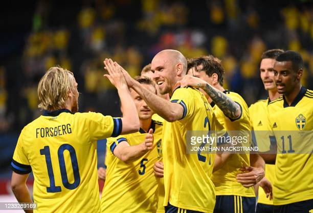 Sweden's defender Marcus Danielson celebrates with teammates scoring during the friendly football match Sweden vs Armenia on June 5 in Solna, in...