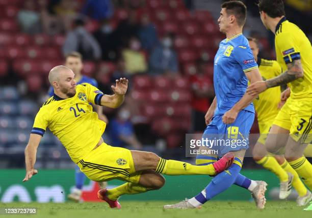 Sweden's defender Marcus Danielson fouls Ukraine's forward Artem Besedin to earn a red card and get sent off during the UEFA EURO 2020 round of 16...
