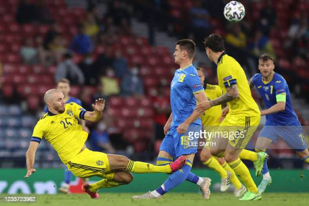 Sweden's defender Marcus Danielsson fouls Ukraine's forward Artem Besedin to earn a red card and get sent off during the UEFA EURO 2020 round of 16...