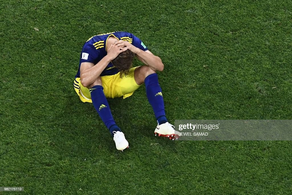 TOPSHOT - Sweden's defender Martin Olsson reacts to the teams loss during the Russia 2018 World Cup Group F football match between Germany and Sweden at the Fisht Stadium in Sochi on June 23, 2018. (Photo by Jewel SAMAD / AFP) / RESTRICTED