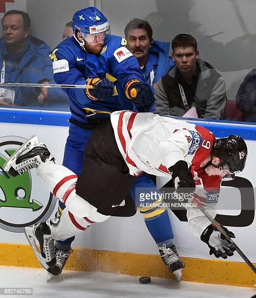 Sweden's defender Mattias Ekholm collides with Canada's forward Matt Duchene during the quarterfinal game Canada vs Sweden at the 2016 IIHF Ice...