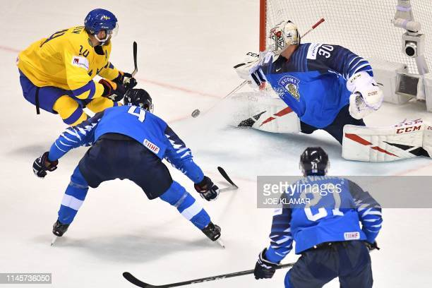 Sweden's defender Mattias Ekholm has his shot stopped by Finland's goalkeeper Kevin Lankinen during the IIHF Men's Ice Hockey World Championships...