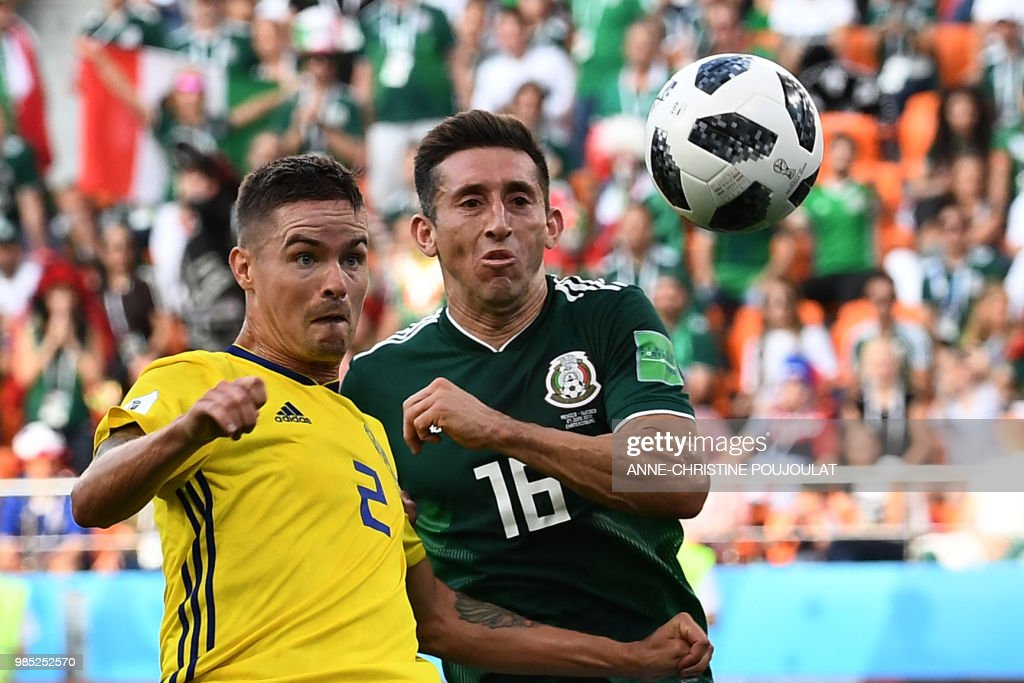 TOPSHOT - Sweden's defender Mikael Lustig (L) and Mexico's midfielder Hector Herrera vie for the ball during the Russia 2018 World Cup Group F football match between Mexico and Sweden at the Ekaterinburg Arena in Ekaterinburg on June 27, 2018. (Photo by Anne-Christine POUJOULAT / AFP) / RESTRICTED