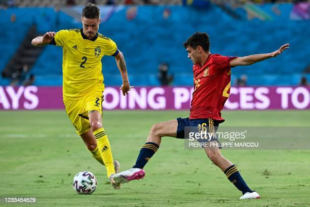 Sweden's defender Mikael Lustig is challenged by Spain's forward Pedri during the UEFA EURO 2020 Group E football match between Spain and Sweden at...
