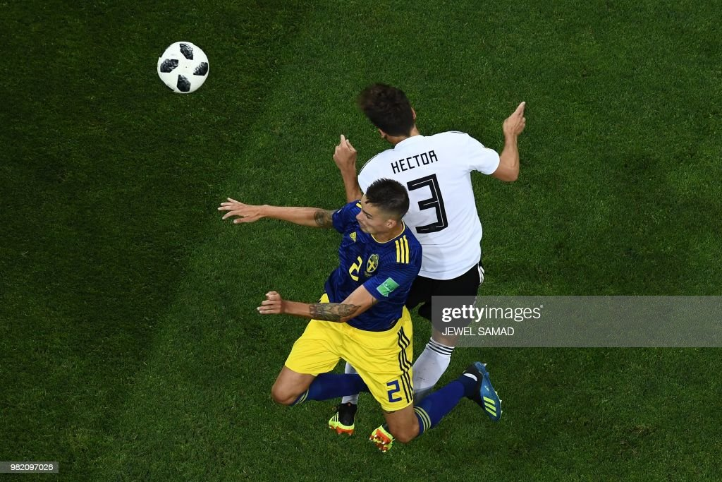 TOPSHOT - Sweden's defender Mikael Lustig (L) vies for the header with Germany's defender Jonas Hector during the Russia 2018 World Cup Group F football match between Germany and Sweden at the Fisht Stadium in Sochi on June 23, 2018. (Photo by Jewel SAMAD / AFP) / RESTRICTED