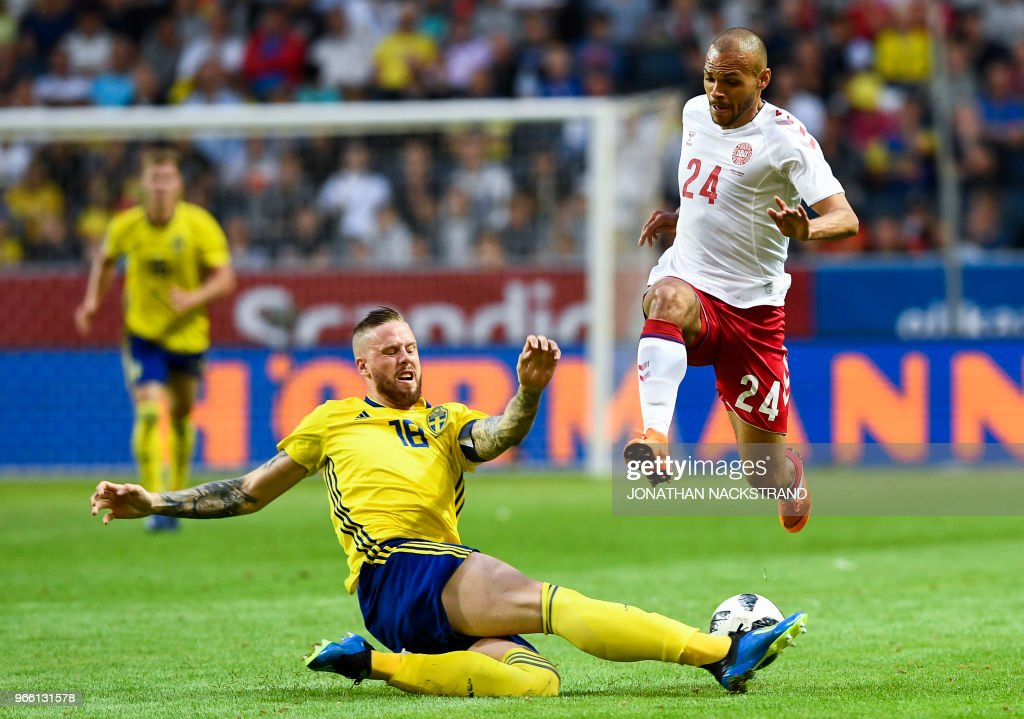 Sweden's defender Pontus Jansson (L) vies with Denmark's forward Martin Braithwaite during the international friendly footbal match Sweden v Denmark in Solna, Sweden on June 2, 2018.