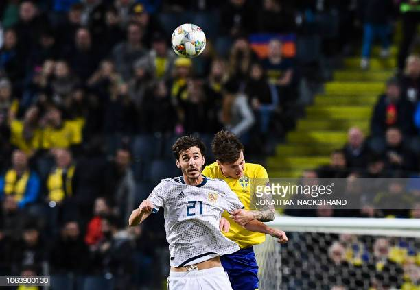 Sweden's defender Victor Lindelof and Russia's midfielder Aleksandr Erokhin jump to head the ball during the UEFA Nations League football match...
