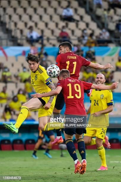 Sweden's defender Victor Lindelof heads the ball with Spain's midfielder Daniel Olmo past Spain's midfielder Ferran Torres during the UEFA EURO 2020...