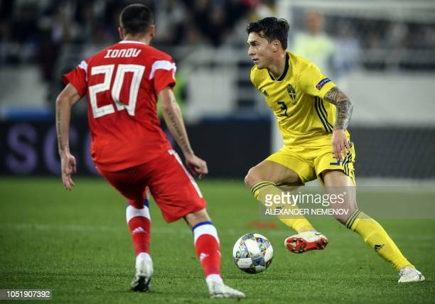 Sweden's defender Victor Lindelof vies with Russia's midfielder Aleksei Ionov during the UEFA Nations League football match between Russia and Sweden...