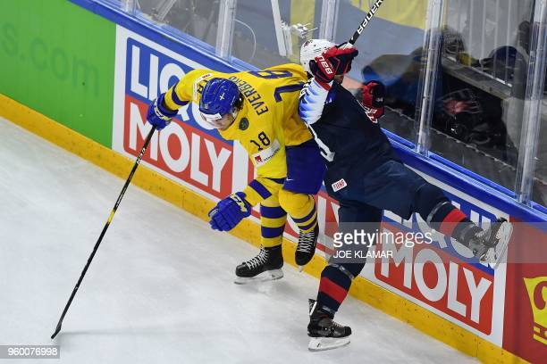 Sweden's Dennis Everberg vie with US Nick Bonino during the semifinal match Sweden vs USA of the 2018 IIHF Ice Hockey World Championship at the Royal...