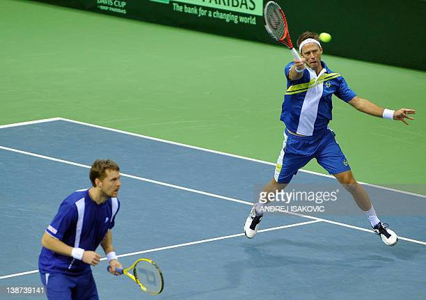 Sweden's double Johan Brunstrom and Robert Lindstedt return a ball to Serbia's double Janko Tipsarevic and Nenad Zimonjic during their Davis Cup...