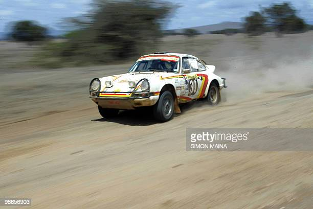 Sweden's driver Bjorn Waldegaard and codriver David Cavanagh from Ireland steer their Porsche in Machakos 09 December 2005 during lastleg of East...