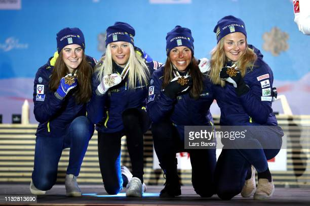 Swedens Ebba Andersson Frida Karlsson Charlotte Kalla and Stina Nilsson celebrate their Gold medals following the Women's 4x5km Cross Country Relay...