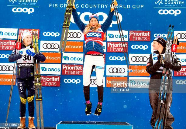 Sweden's Ebba Andersson Norway's Therese Johaug and Jessica Diggins of the US pose on the podium after the women's FIS World Cup 10 km Interval start...