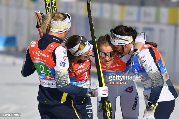 Sweden's Ebba Andersson Sweden's Frida Karlsson Sweden's Charlotte Kalla and Sweden's Stina Nilsson react after the Ladies' cross country skiing...