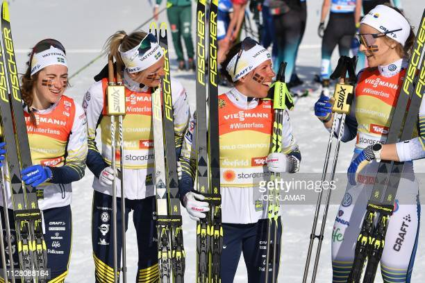 Sweden's Ebba Andersson Sweden's Frida Karlsson Sweden's Charlotte Kalla and Sweden's Stina Nilsson pose after winning the Ladies' cross country...