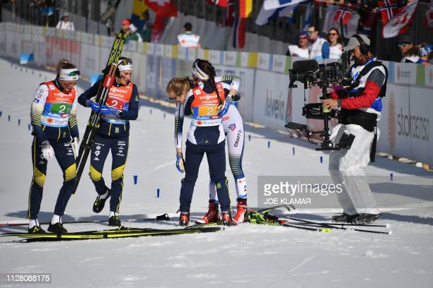 Sweden's Ebba Andersson Sweden's Frida Karlsson Sweden's Charlotte Kalla and Sweden's Stina Nilsson react after winning the Ladies' cross country...