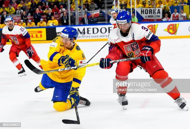 Sweden's Elias Pettersson vies with Czech Republic's Radko Gudas during the group A match Sweden vs Czech Republic of the 2018 IIHF Ice Hockey World...