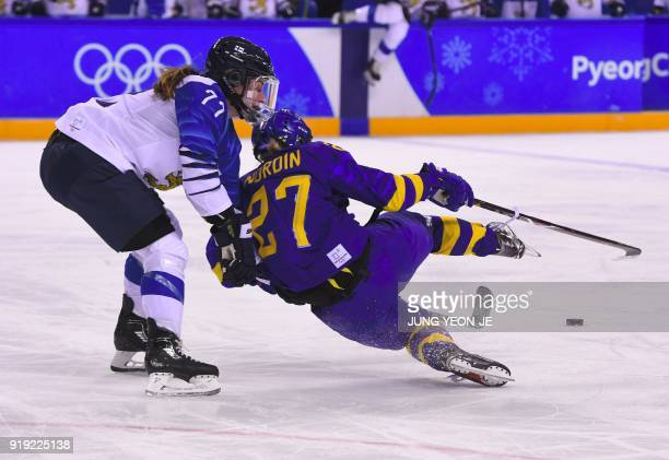 TOPSHOT Sweden's Emma Nordin and Finland's Susanna Tapani fight for the puck in the women's quarterfinal ice hockey match between Finland and Sweden...