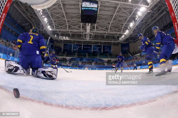 Sweden's Emma Nordin and Sweden's Emilia Ramboldt watch as Sweden's Sara Grahn lets in the game winning goal by Japan's Ayaka Toko in overtime in the...