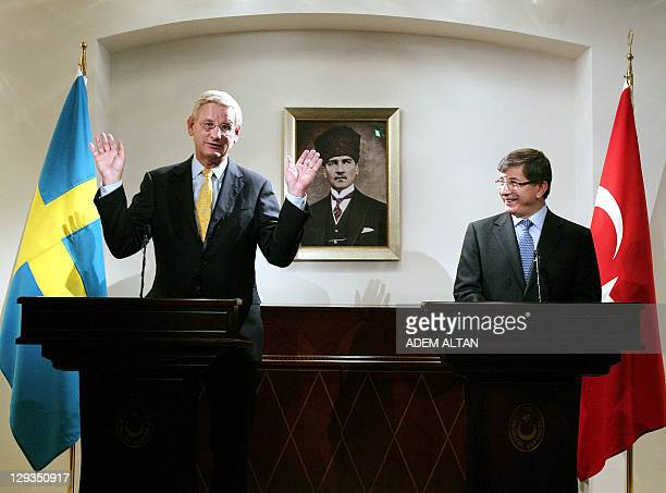 Sweden's Foreign Minister Carl Bildt and his Turkish counterpart Ahmet Davutoglu respond to questions during a press conference following their talks...