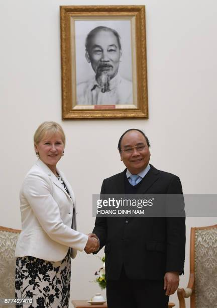 Sweden's Foreign Minister Margot Wallstrom shakes hands with Vietnam's Prime Minister Nguyen Xuan Phuc as they meet at Phuc's Cabinet Office in Hanoi...