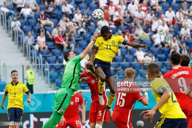 Sweden's forward Alexander Isak and Poland's goalkeeper Wojciech Szczesny jump for the ball during the UEFA EURO 2020 Group E football match between...