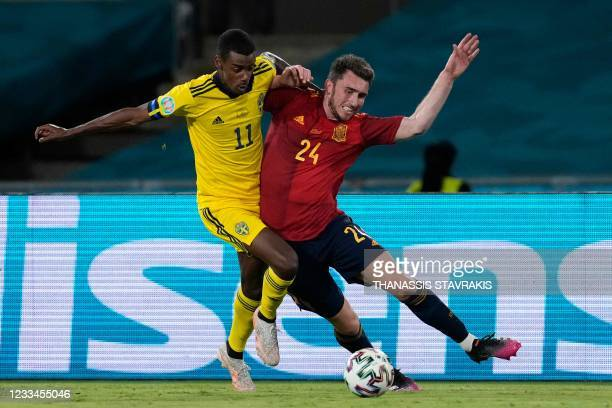 Sweden's forward Alexander Isak vies for the ball with Spain's defender Aymeric Laporte during the UEFA EURO 2020 Group E football match between...