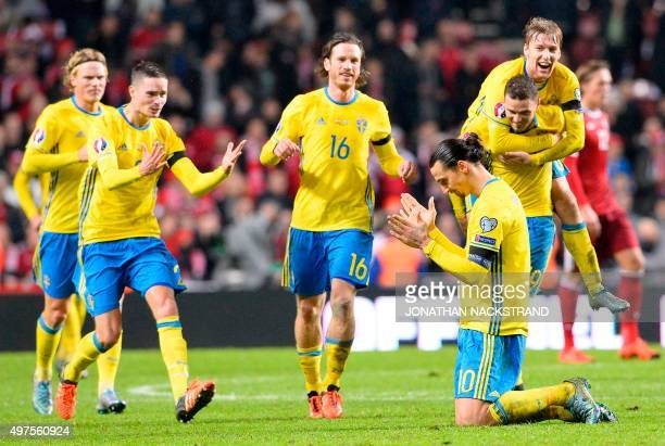 Sweden's forward and team captain Zlatan Ibrahimovic celebrates with his teammates as they qualify to Euro 2016 in France after the Euro 2016 second...