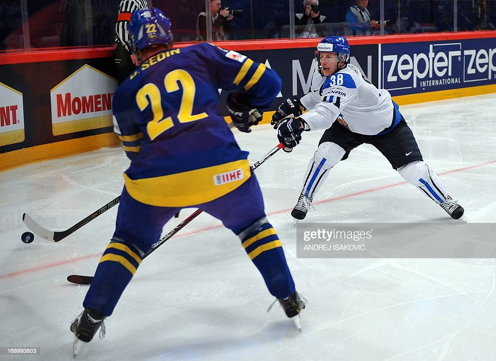 Sweden's forward Daniel Sedin (L) vies with Finland's defender Juuso Hietanen during the semi final match Finland vs Sweden of the IIHF International Ice Hockey World Championship at Globe Arena in Stockholm on May 18, 2013.