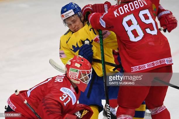 Sweden's forward Dennis Rasmussen and Belarus' defender Dmitri Korobov vie during the IIHF Men's Ice Hockey World Championships preliminary round...