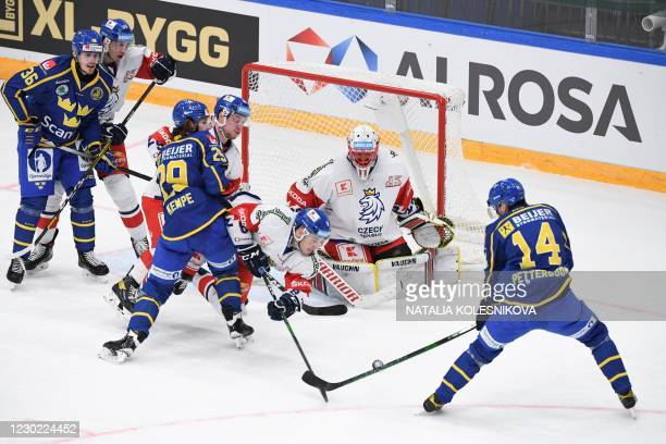 Sweden's forward Emil Pettersson tries to score during the Channel One Cup of the Euro Hockey Tour ice hockey match between Sweden and Czech Republic...