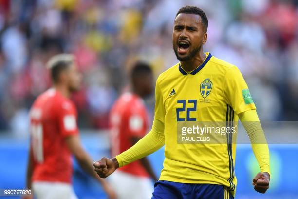 Sweden's forward Isaac Kiese Thelin celebrates their victory at the end of the Russia 2018 World Cup round of 16 football match between Sweden and...