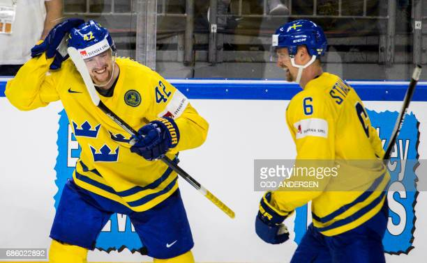 Sweden´s forward Joakim Norsdtrom celebrates his teams fourth goal during the IIHF Men's World Championship Ice Hockey semi-final match between...