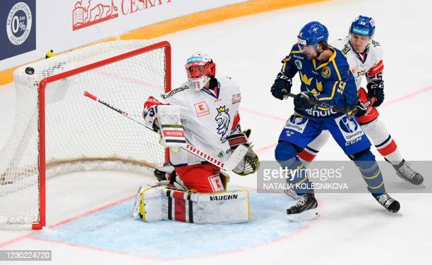 Sweden's forward Linus Johansson tries to score during the Channel One Cup of the Euro Hockey Tour ice hockey match between Sweden and Czech Republic...