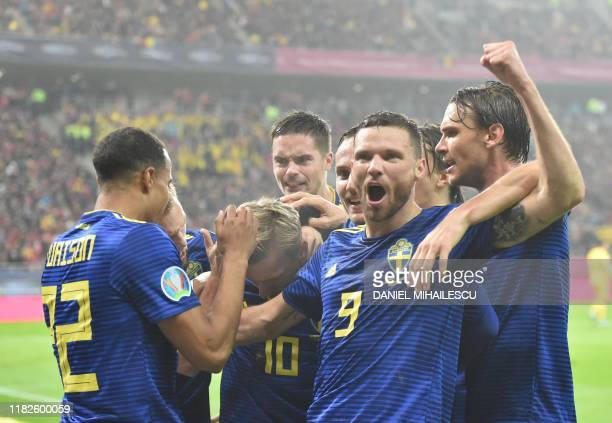 Sweden's forward Marcus Berg celebrates scoring the opening goal with his teammates during the Euro 2020 Group F qualification football match Romania...