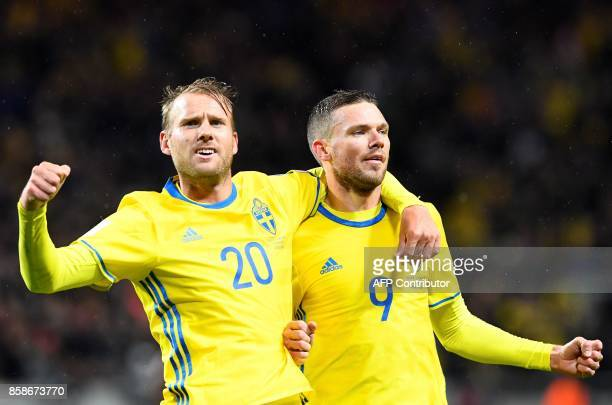 Sweden's forward Marcus Berg celebrates with his teammate forward Ola Toivonen after scoring during the FIFA World Cup 2018 qualifying match between...