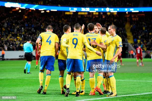 Sweden's forward Marcus Berg celebrates with his teammates after scoring the FIFA World Cup 2018 qualifying match between Sweden and Luxembourg in...
