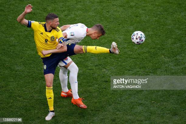 Sweden's forward Marcus Berg challenges Slovakia's defender Lubomir Satka during the UEFA EURO 2020 Group E football match between Sweden and...