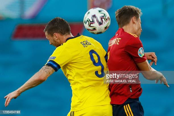 Sweden's forward Marcus Berg heads the ball with Spain's defender Diego Llorente during the UEFA EURO 2020 Group E football match between Spain and...