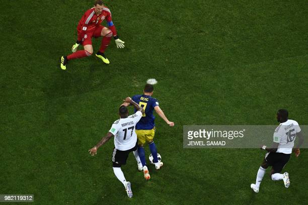 Sweden's forward Marcus Berg is tackled by Germany's defender Jerome Boateng during the Russia 2018 World Cup Group F football match between Germany...